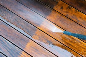 Pressure washing wood surface by Complete Power Wash